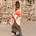 Turkana village - a girl watches the dance