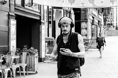 Inked (Cycling-Road-Hog) Tags: blackwhite candid canoneos750d cap citylife colour ef50mmf18stm edinburgh fashion headphones leithwalk mobile monochrome niftyfifty people places scotland smoking street streetphotography streetportrait style tattoo urban