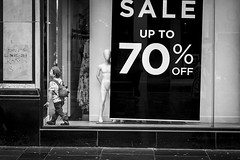 Reductions (Leanne Boulton) Tags: urban street candid streetphotography candidstreetphotography streetlife juxtaposition boy child expression fun joy store shop window display mannequin sign sale reductions playing play tone texture detail depth naturallight outdoor light shade city scene human life living humanity society culture lifestyle people canon canon5dmkiii 70mm ef2470mmf28liiusm black white blackwhite bw mono blackandwhite monochrome glasgow scotland uk