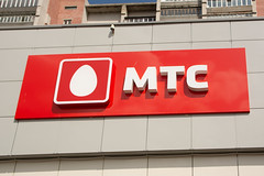 MTS signboard on the street (Jess Aerons) Tags: sign logo media colorful symbol russia moscow background web internet group communication network cis concept russian connection mts telecommunication street new red white building mobile shop facade computer europe technology telephone egg cellular cable business international networking local contact signboard operator branding broadband gsm banking largest global logotype telesystems