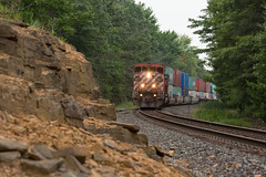 Q19851 (THE Woodtick) Tags: dash840cm c408m bcrail canadiannational wisconsin doublestack intermodal stacktrain cnexwc exsooline exbcrail exwisconsincentral stevenspoint bcol bcolc408m rock sandstone outcrop railroad train clouds trees pinetrees internationaltrade