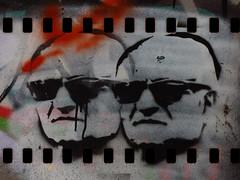 The Gangster Film (Steve Taylor (Photography)) Tags: gangsters twins sunglasses sunnies film stencil streetart digitalart black orange green men texture runs drips
