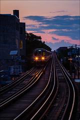 Coming and Going (53768) (Kurt Kramer) Tags: chicago damen el dusk tracks wickerpark bucktown reflection cityscape blueline cta