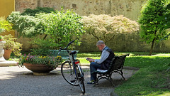 A quiet place to read - Lucca, Italy (TravelsWithDan) Tags: candid garden bench park trees olderman bicycle idylic city urban lucca tuscany italy europe canong9x