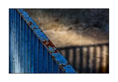 fence blue fence (Armin Fuchs) Tags: arminfuchs lavillelaplusdangereuse würzburg moz mozartschule fence shadows light diagonal blue hff rust metal stripes