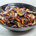 Roasted mushrooms with garlic on black bowl