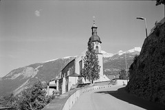 Cathedral of the Assumption of St. Mary (vladixp) Tags: ilford fp4 fp4plus fp480 d76 14min 20c 12 praktica mtl5 flektogon k2 pf7250u 3600dpi 35mm yellowfilter filmscan 35mmfilm film bw bwfilm filmphotography negative scanned graubünden grigioni grisons svizzera schweiz switzerland suisse chur calanda