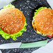 Top view, two homemade hamburgers with knife