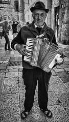 The streets of Bari (Leaning Ladder) Tags: bari italy italia puglia apulia accordion faces blackandwhite bw street leaning ladder leaningladder