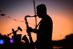 Porto (Gwenaël Piaser) Tags: portugal porto oporto concert saxophone sax backlight silhoutette orange sunset canon eos reflex fullframe canoneos 6d 24x36 eos6d rawtherapee unlimitedphotos canoneos6d gwenaelpiaser prime 85mm usm 85mmf18 ef85mm ef85mmf18usm canonef85mmf18usm ef85mmusm canonef85mm118usm musician music musicien musique shadow black ombre july juillet july2019 1000 portugueserepublic repúblicaportuguesa