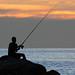 Fisherman on the rocks at sunset. Patong (Kalim) beach, Phuket, Thailand    XOKA9554s