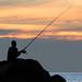 Fisherman on the rocks at sunset. Patong (Kalim) beach, Phuket, Thailand    XOKA9558s