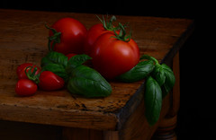 Late Summer Harvest (njk1951) Tags: tomatoes red green woodentable oldwood lowlight summer basil basilico pomodori atmosphere stilllife