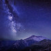 The Delta Aquariids meteor shower and Milky Way over Mount St. Helens, at Windy Ridge in Washington State with Mt. Hood, Oregon visible in the lower left corner