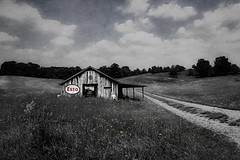 A walk down memory lane. (bigtownhicks) Tags: esso sign americana backroads field flowers barn dirtroad tractor rural countryside farm texture painterly landscape bigsky clouds minnesota tennessee bigtownhicks barbaragrether