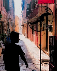 Memories of Corfu | Silhouette of a boy playing in an alley in Corfu town