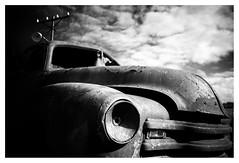 Film noir (leo.roos) Tags: car rust decay kutensbensin crêperietati noiretblanc bw 28 arty m42 helios compo contrast curv kapot lamp pov schaduw ugl gotland fårö heliosautowideangle128f28mm a7 helios2828 madeinjapan swedengotlandspring2019 zweden darosa leoroos sweden sverige 2019