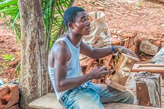 Accra Marketplace craftsman (Pejasar) Tags: man craftsman painting worker market accra ghana westafrica