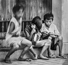 Counting their Christmas bounty (FotoGrazio) Tags: makingaliving youngboys streetkids socialdocumentaryphotography documentaryphotography waynesgrazio travelphotography vigan people fotograzio feet poverty countingmoney philippines children money lifeinthephilippines sandals streetscene poor waynestevengrazio monochrome waynegrazio motion streetphotography filipino movement kids street blackandwhite boys travel