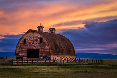 Couple of Cupolas (D E Pabst Photography) Tags: fence asotincounty barn cupola southeastwashington sunset wooden clouds