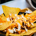 Cripsy nachos served with cheese and beef