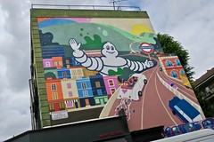 Michelin Mural, London, UK (Robby Virus) Tags: london england uk unitedkingdom britain greatbritain gb street art ladbroke grove sign mural michelin man wave waving notting hill portobello road building petra eriksson
