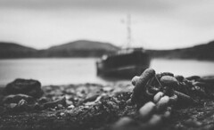 Going nowhere (Matthew Johnson1) Tags: boat chain beach sea hills coast water outdoors landscape nobody blackandwhite bw silent quiet calm rocks sand f14 sigma canon 700d