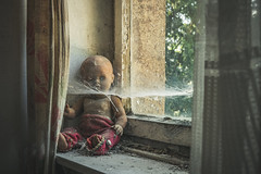 Left Behind (Some Place Only We Know) Tags: doll puppe creepy alone left behind spinnenweben spiderweb spinnennetz urbex urban exploration decay abandoned old gruselig window fenster