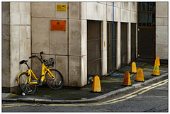 The Yellow Zone (donbyatt) Tags: london yellow bikes cones parking signs
