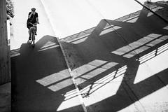 Peace, Uppsala, June 28, 2019 (Ulf Bodin) Tags: uppsala sverige walking outdoor bike peace cyklist summer contrast road monochrome bicycle skugga sweden shadow canonrf85mmf12lusm blackandwhite streetphotography canoneosr cykel urbanlife uppsalalän