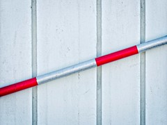 Red and silver pole against grey wall (Steve Brewer Photos) Tags: iceland reykjavik minimalist abstract geometric geometrical colour color line lines pattern repetition minimal rhythm straight straightline straightlines