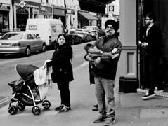 papa – Pentax smc K 3.5/28 (Argon X) Tags: argonx sikh proud relaxed man baby woman wife beard moustache streetphotography family turban carrying eyecontact