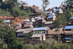 The Village On The Hillside (peterkelly) Tags: digital canon 6d asia southeastasia laos mekongriver indochinaencompassed gadventures village home house roof hillslope hillside trees