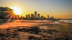 Mini Durban (Andy.Gocher) Tags: andygocher canon100d miniaturemode minimode tiltshift south africa durban beach sunset coastline sunrays lens flare sand