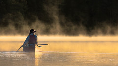 Looking for moose (Jerzy Orzechowski) Tags: paddling landscape sunrise people fog water reflections boat canada lake algonquin yellow canoe