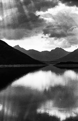 Loch Quoich (Francis Mansell) Tags: lochquoich lochcuaich loch lake water reflection sky sunbeam cloud mountain sgùrrnacìche beinnanaodainn benaden monochrome blackwhite niksilverefexpro2 scotland scottishhighlands scan scanned scannedfromnegative negative grainy filmgrain reservoir