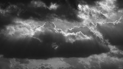 Over Ocean And Earth (Fourteenfoottiger) Tags: stormy clouds sunlight sunshine sunrays rays contrast brooding monochrome mono blackandwhite sky helios44m