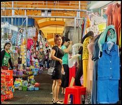 Shopping, Psar Thmey. (the jacal) Tags: cambodiacambodge cambodia cambodge southeastasia psar market centralmarket psarthmey beauty clothes phnompenh artdeco colonialarchitecture frenchcolonialarchitecture olympusem10 olympus women woman