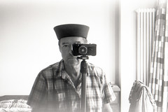 reflected self-portrait with Contax 1a camera and black hat (pho-Tony) Tags: cameraselfportraits contax1a zeiss ikon zeissikon tessar 5cm 50mm f28 dresden zeissikonagdresden broken faulty 1932 german germany rangefinder 35mm focalplaneshutter vintage film analog analogue iso 12 iso12 rodinal longexposure orwo np8 orwonp8 ma8 orwoma8