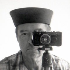reflected self-portrait with Contax 1a camera and black hat (square crop) (pho-Tony) Tags: square cameraselfportraits contax1a zeiss ikon zeissikon tessar 5cm 50mm f28 dresden zeissikonagdresden broken faulty 1932 german germany rangefinder 35mm focalplaneshutter vintage film analog analogue iso 12 iso12 rodinal longexposure orwo np8 orwonp8 ma8 orwoma8