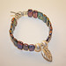 Precious metal clay leaf and iridescent stick pearls bracelet