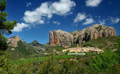 Les Mallos de Riglos (davidpemberton78) Tags: crag mountain rocks village sunlight clouds spain huesca aragon towering