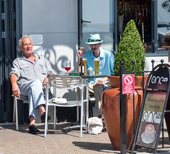 That doesn't look like coffee (sasastro) Tags: streetphotography bar hats men blue table sitting felixstowe