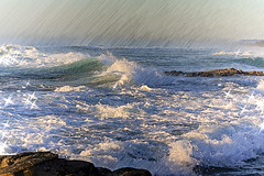Having Fun with Waves. (womboyne7) Tags: slidersunday hss pointarkwright sunshinecoast queensland waves ocean water green blue white rocks