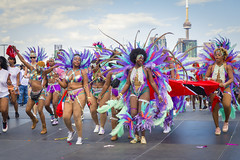 Toronto Carnival 2019 (A Great Capture) Tags: agreatcapture agc wwwagreatcapturecom adjm ash2276 ashleylduffus ald mobilejay jamesmitchell toronto on ontario canada canadian photographer northamerica torontoexplore summer summertime été sommer 2019 caribana exhibitionplace theex west end cultural multicultural diverse parade stage cntower torontocarnival caribana2019 caribbeancarnival torontocarnival2019 caribbean carnival diveristy canon eos 6d mark ii ef2470mm city downtown lights urban fun colours colors colourful colorful digital dslr lens outdoor outdoors outside vibrant cheerful vivid bright costume festivals festival