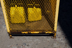 Caged Jerry Cans (JeffStewartPhotos) Tags: yellow cage caged jerrycans gas gasoline containers cans protected stored toronto ontario canada walkingwithvickii dimsumphotowalk dimsumwalk jsp2019080269 jsp7701