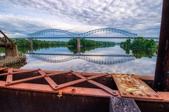 Providence & Worcester railroad bridge #3 (tquist24) Tags: arringonibridge connecticut connecticutriver hdr middletown nikon nikond5300 outdoor providenceworcesterrailroadbridge clouds geotagged industrial outside rail railroad railroadtracks rails reflection reflections river sky steel swingbridge tracks traintracks trees trussbridge water