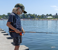 A Kid and his fishing... (Troy Strane) Tags: fishing southhaven michigan summer tourism lighthouse lake nikon d850