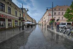 rainy day (rafasmm) Tags: łódź lodz poland polska europe city citycenter street streetphotography urban rain outdoor reflection walk color nikon d90 sigma 1020 ex sky