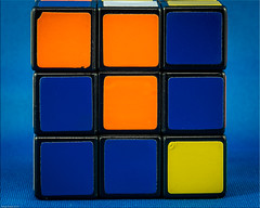 Complementary Colours:  Rubik blue and orange plus a dash of yellow (Photoma*) Tags: complementarycolours macro macrodreams macromondays toy rubikscube